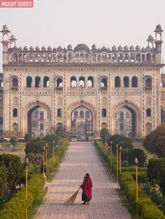 A woman worker and her broom at The Bara Imambara in Lucknow, India