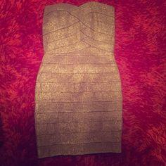 Gold Bandage dress L'atiste gold bandage dress. Never worn. Dresses Mini