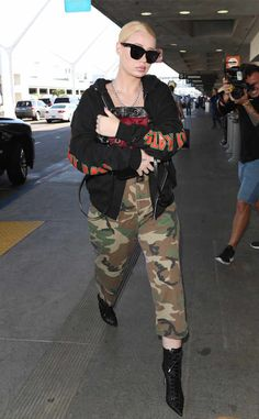 Eye spy Iggy Azalea! Despite her best efforts to keep a low profile under camo pants and oversized sunnies, the star was spotted in Los Angeles.  Military fierce! The rapper pairs camouflage pants with heels in Los Angeles.