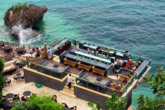 Resort bar overlooking the sea and waves | Murray Mitchell