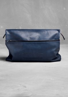 & Other Stories Leather clutch in Indigo GBP79