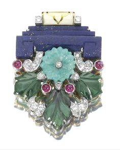 Lapis lazuli, carved emerald, diamond and ruby brooch, Cartier, circa 1930.