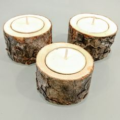 Set of 3. Size: 1.5 tall, 2 diameter These rustic candle holders house standard tea lights, and are made from pine gathered locally in BC. They are well dried and ready to use! Add a bit of warmth to your home or use as centre pieces for weddings or other gatherings. Contact me for