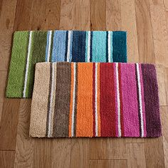 Stripe Bath Rug - A zesty stripe pattern in your choice of cool marina blues or warm orange and berry tones.