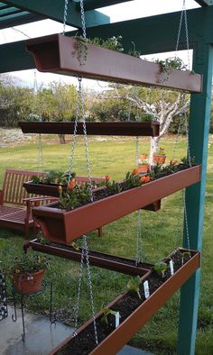 http://fashion881.blogspot.com - Hanging garden. I saw something similar on Pinterest but I couldnt figure out what materials they used. So I made this myself out of rain gutters! The DIY posted some specialty hardware that I couldnt find, so I used 1 lengths of chain, S hooks, and I hooks.