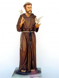 st.+f4ancis | St Francis of Assisi stands in his full gown with two Doves on him.