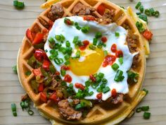This savory brunch includes garlic as well as fresh herbs in the batter, and then tops the waffles with quickly cooked peppers, sausages, and a runny fried egg.
