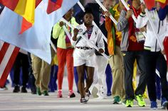 Flag bearer Simone Biles of United States walks during the 'Heroes of the Games' segment during the Closing Ceremony on Day 16 of the Rio 2016 Olympic Games at Maracana Stadium on August 21, 2016 in Rio de Janeiro, Brazil.