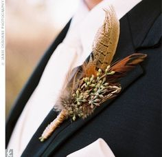 Pheasant feather boutonniere will go great with a camo tux vest.