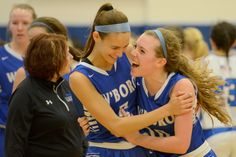 From left, Whitesboro Maria Lapertosa and Kristyn Deuel hug after winning the Section III Class A semifinals for girls basketball against Camden at the SRA arena at Onondaga Community College Saturday, Feb. 28, 2015. Tina Russell / Observer-Dispatch