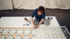 DIY Network shows you how to liven up old hardwood floors by stencil painting a beautiful exotic rug pattern.