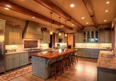 Love the spaciousness and the warmth created by the lights and the wood.