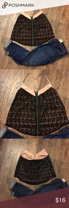 U.O women's black/pink lace zip t-strap top. This is one of a kind! Perfect for a night out with some heels and skinnies 🖤 black lace overlay with a pink/nude underlay. It's fully lined so not see-through. Hangs loose and is super cute with the full front zip. Make it yours! Urban Outfitters Tops Tank Tops