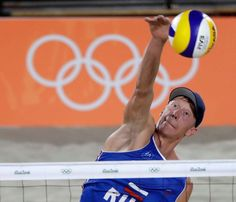 Russia's Dimitri Barsouk hits over the net against Netherlands during a men's beach volleyball match at the 2016 Summer Olympics in Rio de Janeiro, Brazil, Saturday, Aug. 6, 2016.