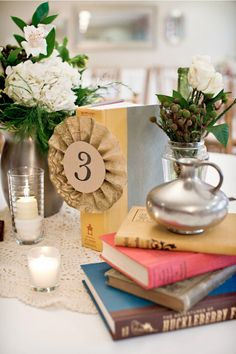 Love the books incorporated into the centerpiece.  Notice the book is Harry Potter? Would be a awesome way to get tie in my main (fictional) man. ;)