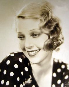 In this image, Loretta Young is sporting the finger wave hairstyle, a very popular hairstyle in the 1930's. This chic, flirty hairstyle is characterized by waves, that stick closely to the face. Although this style was style was very popular, hair was more grown out than in previous decades and there was also many new hair products for women to experiment with! The finger wave is seen in many decades throughout history.