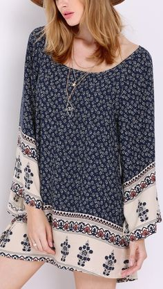 Let your style shine through your apparel choices. Seen here is a navy long sleeve vintage print dress.