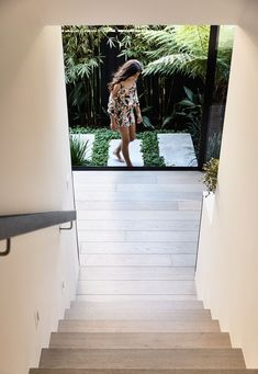 Jamison Architects have designed Masuto, a contemporary duplex in Melbourne, Australia, that features open plan social areas and abundance of light. Loft Design, House Design, Wood Stairs, House Stairs, Double Garage Door, Melbourne, Island With Seating, Timber Cladding, Built In Bench