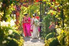 Bride and bridesmaids arriving in the gardens of Braxted Park