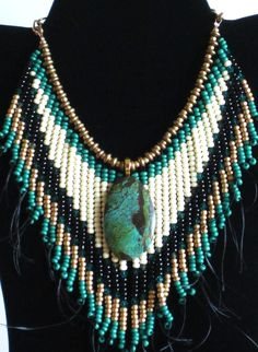 Native American style tribal fringed collar necklace in turquoise and gold with turquoise pendant www.etsy.com/listing/189599345/native-american-style-tribal-fringed?ref=shop_home_active_9