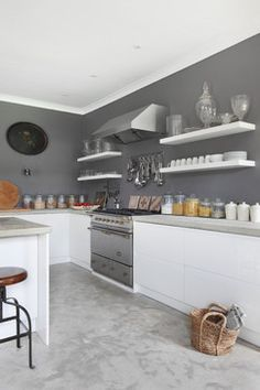Dorset Stable Conversion farmhouse-kitchenPolished concrete in grey could also look good with stainless steel appliances