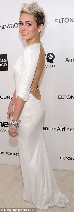 Heavenly: Miley Cyrus took a break from her recent punk rock-style and looked heavenly in a white backless gown which complemented her platinum blonde hair