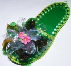 Shoes made from recycled plastic and a little crochet. The flower is made from plastic bottles too! I'd have to add a non-slip sole to the bottom.