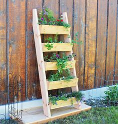 Propped against a fence, this cedar planter provides an eye-catching way to display your favorite blooms. Bonus: It only costs $20 to make. Get the tutorial at Ana White.   - CountryLiving.com