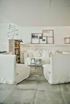 Tramuntana Hotel white linen sofa and pale wood combo Hege in France