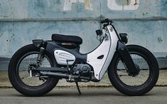 The result of the K-speed rebuild is a cool retro bike that pays tribute to the original Honda Super Cub by mixing old school charm with modern features. Honda Cub, Honda Scooters, Honda Bikes, Scooter Custom, Custom Bikes, Small Motorcycles, Vintage Motorcycles, Womens Motorcycle Helmets, Scooter Motorcycle