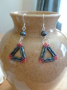 Grey gunmetal bugle beads, seed beads, and round black beads. Triangle, dangle earrings $10