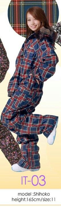 Shihoko is wearing a belted navy blue, red, & white plaid pattern onesie.
