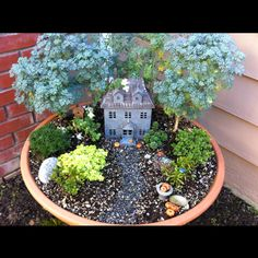 Mom's mini garden chateau. It would be cute to change up the houses for the different holidays