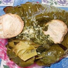 Palusami is a main dish from Samoa made with coconut milk. In the islands of Samoa, we use taro leaves and the Samoan corn-beef but here in America, my family can not live with out it so we use other substitute you can buy at the grocery store. Tongan Food, Samoan Food, Palusami Recipe, Canned Corned Beef, Polynesian Food, National Dish, Island Food, International Recipes, Fish Recipes