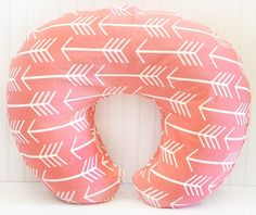 Our Coral Arrow Nursing Pillow is functional and cute! Coordinate your coral nursing pillow with our Wanderlust in Coral Crib Collection.