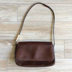 "Fossil  small brown leather purse Barely used leather fossil purse from the 90s. My mom bought this new and pulled it from the depths of her closet to give to me. In immaculate condition. 10""x6"" body with 28"" inch strap. Fossil Bags"
