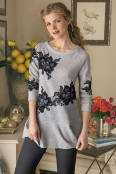 Strategically placed, velvet appliqué blooms twine across the front and sleeves of this consummately cozy, French terry tunic. Double-needle stitching, raglan sleeves a