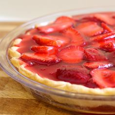 """Strawberry Pie 3 Tbls cornstarch 1 1/2 c sugar (It is a SWEET dessert, you might want to reduce the sugar.  We like it sweet)  1 1/2 cups water  3 oz box strawberry Jell-O 2 cups sliced strawberries Pre-bake a 10"""" pie shell.  Line bottom w sliced strawberries. Combine cornstarch, sugar and water in small saucepan.  Bring to a boil and simmer, stirring constantly, until thickened.  Add the Jell-O and stir until dissolved.  Pour over the strawberries and refrigerate until set.Serve w whipped cream"""