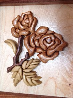 This wooden rose flower intarsia measures 9in wide by 10 in tall and is 1 1/4 in thick. It is handcrafted from Cherry, Poplar, Walnut and Sapele woods. This listing is for the item pictured. This wood