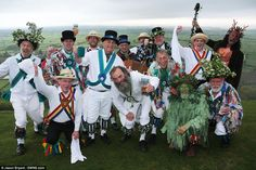 Cam Valley Morris and Mendip Morris Men join druids on top of Glastonbury Tor in Somerset at dawn this morning