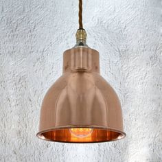 A beautiful hand-spun copper shade, finished with our cotton braided flex.Choose from 9 colours of flexThis small but stunning light is a homage to industries past and has been modelled on a shade from a vintage industrial task lamp. Presented in an elegant copper finish, our version is perfect for both contemporary and traditional interiors. Item includes the following: 1 x Copper shade (14cm diameter; 14cm height), 1m of braided flex (your choice of colour), 1 x Ceiling plate (with cord…