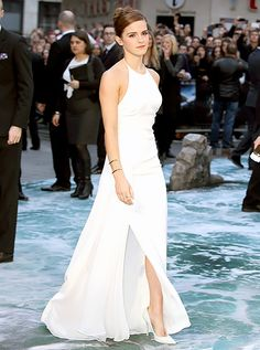 March 31, 2014 Emma Watson in a slim-fitting Ralph Lauren Collection dress, gold Jennifer Fisher cuff bracelets and white Jimmy Choo pumps.