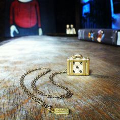 Love this shot of our Suitcase Pendant!  #omericaorganic #suitcasenecklace #travel