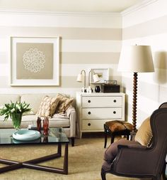 warm stripes and another dresser used in a living room