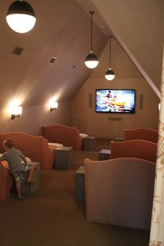 Movie theater in the attic with lounge/beds. Great way to use attic space!