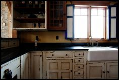 Gorgeous soapstone counters, distressed cabinets, apron sink