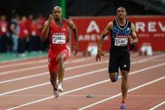 Le sprinteur français Jimmy Vicaut dans le sillage du Jamaïcain Asafa Powell au meeting Areva de Paris, le 4 juillet 2015