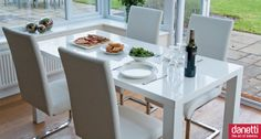 The Fern White Gloss dining table has a classy minimalistic design with simple, smooth straight lines that make the Fern stand out from the crowd. Its high gloss, pure white surface reflects light, automatically creating the illusion of space in your dining area. The high quality wooden lacquered finish provides a long lasting and hard-wearing finish - perfect for busy every day life.  The Fern seats up to 6 people and looks great with white, black or funky coloured chairs. £199.00