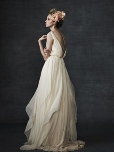 Flowing chiffon gown. Very pretty and love the low cut back, perfect for a summer wedding by a pristine creek.