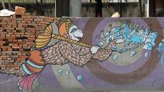 Hanuman the flying monkey-god carries a city and a golden sceptre - though it looks like he's carrying bricks.